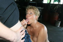 Horny milf Tracy sucking big dick of young construction worker